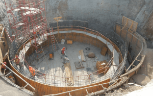 construction workers building circular structure