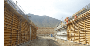 crew building wall with mountains in the background